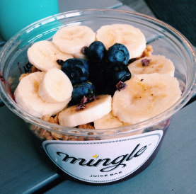 Organic açaí blended with blueberries and topped with banana, granola, banana, cacao nib, and raw honey