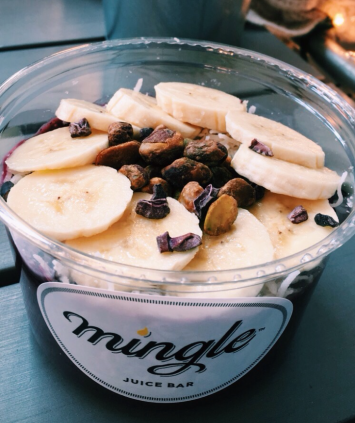 Organic açaí blended with berries & coconut cream topped with banana, cacao nib, pistachio, and shredded coconut